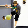 Globe/T. Rob Brown<br /> Nich Taylor kicks the ball during a game of speedball Thursday morning, March 8, 2012, during physical education class at Joplin East Middle School. Students have physical science in a temporary gymnasium.