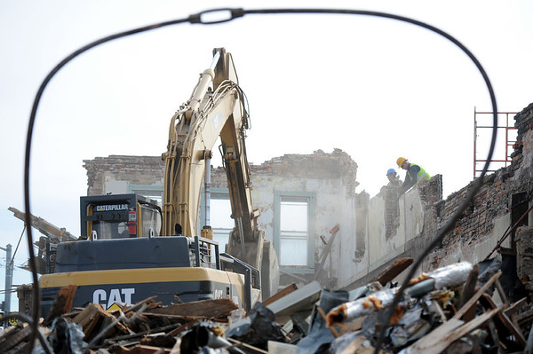 Globe/T. Rob Brown<br /> Rick Sunday, equipment operator with Gator Demolition, uses a track hoe to knock down a building Tuesday morning, March 6, 2012, on the southwest corner of the main intersection, Main Street and 7th Street, in Galena, Kan.