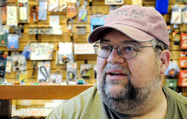 Globe/T. Rob Brown<br /> Tim Homesley, master angler and owner of Tim's Fly Shop near Roaring River State Park near Cassville, talks about his shop, customers and fly tying Thursday afternoon, March 2, 2012.