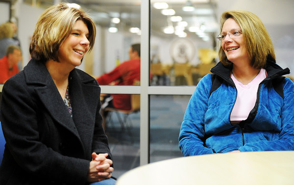 Globe/T. Rob Brown<br /> Project Graduation Committee members Cari Putnam and Lynda Banwart smile as they talk Monday morning, March 5, 2012, at Joplin High School's junior and senior campus about Dr. C.J. Huff's announcement that President Barack Obama will give the Joplin High School commencement address on May 21, 2012.
