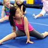 Globe/T. Rob Brown<br /> Six-year-old Emalee Ro, of Joplin, stretches during class Tuesday evening, March 13, 2012, at the new Amplify Gymnastics & Cheer facility in the Joplin Industrial Park.
