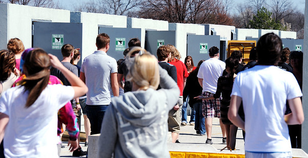Globe/T. Rob Brown<br /> Students head to storm shelters during a tornado drill Tuesday afternoon, March 13, 2012, behind Joplin High School's junior and senior campus at Northpark Mall.