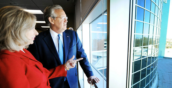 Globe/T. Rob Brown<br /> Gov. Jay Nixon takes a moment to look out of a fifth-floor window with Freeman Health System CEO Paula Baker during the governor's tour of the hospital's newly-opened expansion Monday afternoon, March 12, 2012.