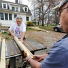 Globe/T. Rob Brown<br /> Roger Beason, left, cuts a board for his new deck with help from friend Doug West Wednesday morning, March 14, 2012, behind Beason's Columbus, Kan., home.
