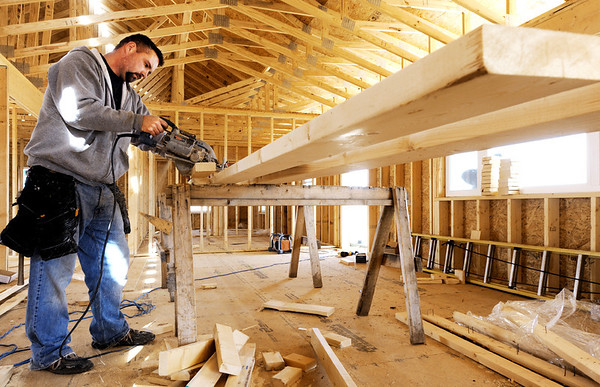 Globe/T. Rob Brown<br /> Logan Kelley, framer with EM Construction, of Diamond, cuts boards Wednesday morning, March 7, 2012, during the final stages of framing for a home near the intersection of 25th Street and Reinmiller Road in Duquesne.