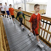 Globe Photo Illustration/T. Rob Brown<br /> Pictured from left: Xavier Cottle, Jackson Owens, Logan Allen, John Hardin, Nich Taylor and Michael Jordan walk to the Joplin East Middle School's gymnasium Thursday morning, March 8, 2012, for physical education class. Students have P.E. in a temporary gymnasium.