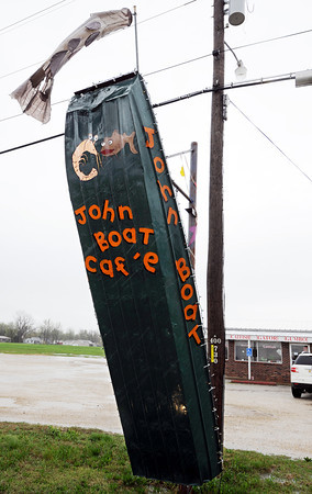 Globe/T. Rob Brown<br /> A john boat outside the Johnboat Caf'e, owned by John Housela, in Duenweg.