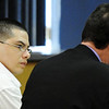 Globe/T. Rob Brown<br /> Kaston Hudgins, of Galena, Kan., looks over at his defense attorney, Shane Adamson, during the start of his murder trial Wednesday afternoon, March 14, 2012.