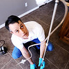 Globe/T. Rob Brown<br /> Mark Wolfe, owner of Joplin Mold Inspection & Remediation, looks up at air tubing connected to an air cassette Friday morning, March 9, 2012, at a Joplin home. The apparatus is connected to an air sampling pump (on floor, at left) that traps any mold in the air. The cassette is then sent in to a laboratory for analysis.