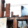 Globe/T. Rob Brown<br /> Joplin firefighters battle a smaller blaze that started back up Friday morning, March 2, 2012, at the Rains Brothers building, which caught fire late Thursday night.