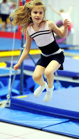 Globe/T. Rob Brown<br /> Six-year-old Kaya Cooper bounces on a trampoline during class Tuesday evening, March 13, 2012, at the new Amplify Gymnastics & Cheer facility in the Joplin Industrial Park.