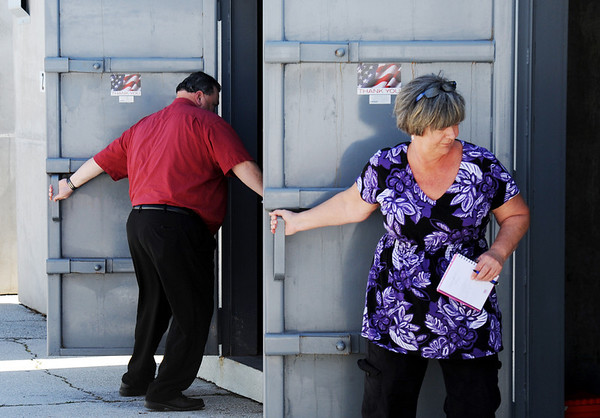 Globe/T. Rob Brown<br /> Jan Crandon, special education teacher, right, and Junior Principal Greg Boyd close doors to storm shelters during a tornado drill Tuesday afternoon, March 13, 2012, behind Joplin High School's junior and senior campus at Northpark Mall.