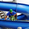 "Globe/T. Rob Brown<br /> Jereme Glenn, a caretaker with Joplin Parks & Recreation, maneuvers down a new water slide during installation Wednesday afternoon, March 28, 2012, at Cunningham Park Pool. This 16-foot-tall and 40-foot-long slide was donated by the city of Fort Scott, Kan., as part of the Joplin tornado recovery efforts. In addition, the city of Joplin is installing a 28-foot-tall, four-flume slide. ""This is going to be the pool to be at this summer,"" said Chris Cotten, Joplin Parks director. ""We're real excited. It's going to come together nicely."" Cotten said the aquatic center will also feature a new toddler play area with a miniature slide, water cannons, climbing nets, dumping bucket and more. Also, the rebuilt building now has hurricane straps, metal tie-downs and reinforced walls."
