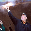 Globe/T. Rob Brown<br /> Missouri Gov. Jay Nixon fires the starting shot for trout fishing next to First Lady Georganne Nixon Thursday morning, March 1, 2012, at Roaring River State Park in Cassville, Mo. Bill Bryan, left, Missouri State Parks director, takes the governor's photo.