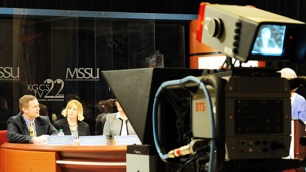 Globe/T. Rob Brown<br /> Dr. C.J. Huff, Joplin School District superintendent, speaks on camera as Dr. Angie Besendorfer, assistant superintendent, looks on Wednesday evening, March 28, 2012, at MSSU's KGCS TV 22 studio.