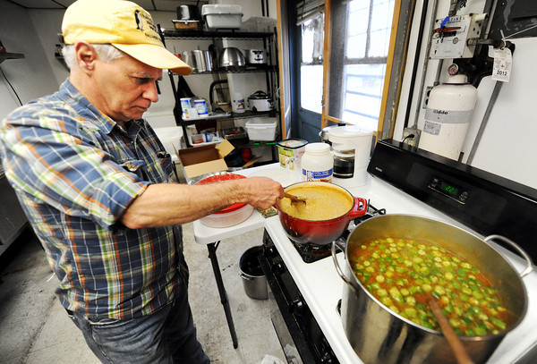 Globe/T. Rob Brown<br /> John Housela, owner of Johnboat Caf'e in Duenweg, stirs a pot of green chili Wednesday afternoon, March 21, 2012.