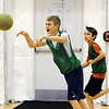 Globe/T. Rob Brown<br /> Logan Allen passes the ball during a game of speedball Thursday morning, March 8, 2012, as teammate John Hardin looks on from behind, during physical education class at Joplin East Middle School. Students have physical science in a temporary gymnasium.
