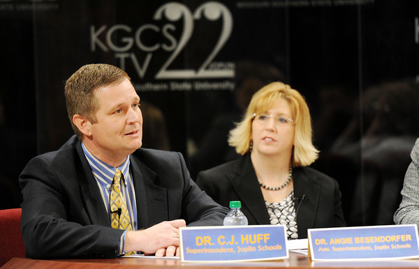 Globe/T. Rob Brown<br /> Dr. C.J. Huff, Joplin School District superintendent, speaks as Dr. Angie Besendorfer, assistant superintendent, looks on Wednesday evening, March 28, 2012, at MSSU's KGCS TV 22 studio.