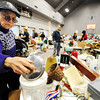 Globe/T. Rob Brown<br /> Darlene Brayfield, of Joplin, looks through items on a table at the First United Methodist Church Annual Rummage Sale Wednesday morning, March 21, 2012, in Joplin.