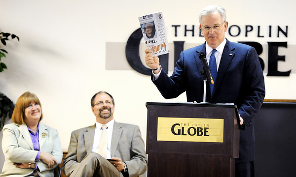 Globe/T. Rob Brown<br /> Gov. Jay Nixon speaks Monday afternoon, March 12, 2012, at The Joplin Globe offices about the value of newspaper reporting and its impact on the community during the May 22, 2011, tornado and its aftermath. Joplin Globe Editor Carol Stark, left, and Publisher Michael Beatty look on.