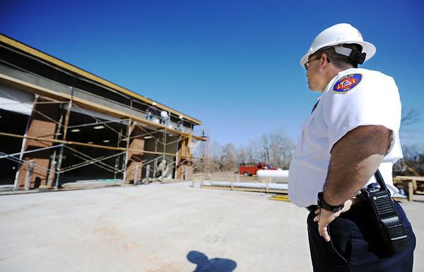 Globe/T. Rob Brown<br /> Chief Mitch Randles oversees construction of the new Joplin Fire Department Station No. 6, Friday afternoon, March 9, 2012.