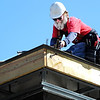 Globe/T. Rob Brown<br /> Roofer Roger Colborn, of Frontenac, Kan., with Mid-America Roofing, works on the roof of the new Joplin Fire Department Station No. 6, Friday afternoon, March 9, 2012.