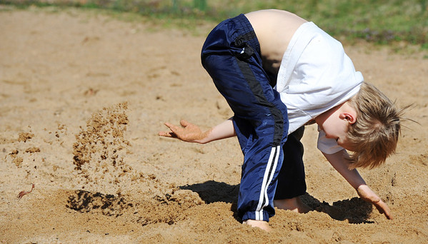 Globe/T. Rob Brown<br /> Eight-year-old Garron Koehler, of Joplin, pretends he's a dog, according to the boy's mother, while playing in the sand at the Landreth Park sand volleyball court Monday morning, March 12, 2012.