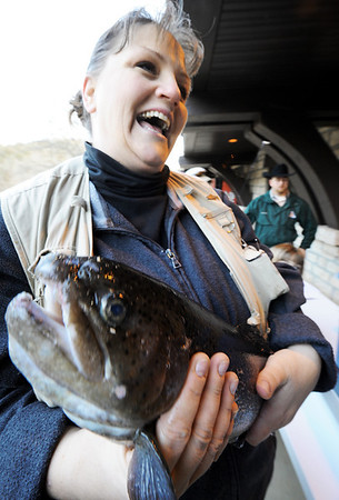 Globe/T. Rob Brown<br /> Angela Seymour, of Cassville, smiles as she find out her fish weighed in at 5.18 pounds Thursday morning, March 1, 2012, at Roaring River State Park in Cassville, Mo. She said it is the biggest one she has ever caught.