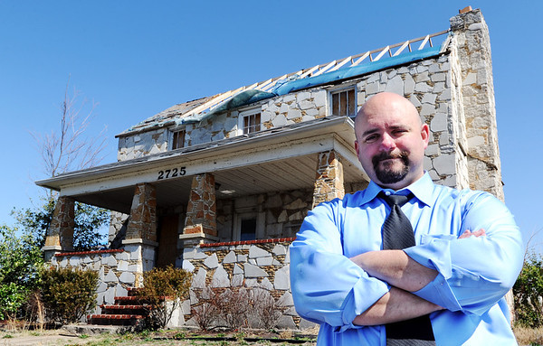 """Globe/T. Rob Brown<br /> Ray Goodman, of Columbia, stands in front of his parents' Joplin home Friday afternoon, March 9, 2012, near Schifferdecker Avenue and 32nd Street. Goodman's father, Jess """"J.T."""" Goodman died following the May 22, 2011, tornado."""