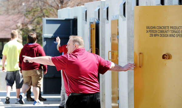 Globe/T. Rob Brown<br /> Junior Principal Greg Boyd directs students as they head to storm shelters during a tornado drill Tuesday afternoon, March 13, 2012, behind Joplin High School's junior and senior campus at Northpark Mall.
