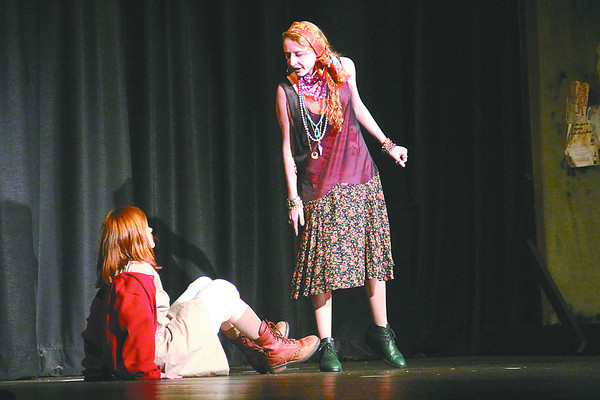 "Western Boone senior Kate Emmert, right, playing Mrs. Hannigan, and eighth-grader Katie Mantooth, playing Annie, rehearse Friday for the school's production of the 1977 Broadway musical, ""Annie."" Because Emmert is a senior, she said this last musical at WeBo is bittersweet. ""This show is going to take everyone by surprise,"" she said. ""It's going to be awesome.""<br /> Performances will be at 7 p.m. Friday and Saturday, and 2:30 p.m. on Sunday, in the high school auditorium. Tickets are $5 or $7, depending on the seats. Reserve tickets by emailing ali.long@webo.k12.in.us or calling 765-482-6143, ext. 3125."