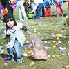 Isabella Olmos, 3, adds another egg to her collection during the Lebanon Park Department's Easter egg hunt Saturday.