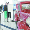Marilyn Smith of Thorntown photographs a car owned by 1930s-era bank robber John Dillinger during an unveiling of the 1933 Essex Terraplane at the Indianapolis International Airport.
