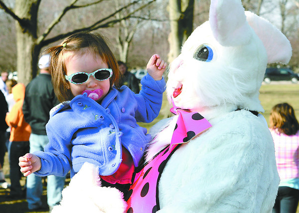 Aliviah Long, 2, meets the Easter Bunny before the start of the Lebanon Park Departmen'ts Easter egg hunt Saturday at Memorial Park.