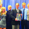 Scott Carney of RadioMom 91.1 FM in Lebanon, shown above with members of his family, was recently honored for receiving the Distinguished Service Award from the Indiana Interscholastic Athletic Administrators Association. The award is given to a person who has made a significant contribution to his or her local high school. Carney has been broadcasting live play-by-play coverage of Lebanon, Western Boone and Zionsville baseball, basketball and football for more than 25 years. A graduate of Western Boone Jr.-Sr. High School, he is a life resident of Boone County.