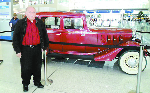 Butch Smith of Thorntown, at the Indianapolis International Airport with a car driven by John Dillinger, has been a student of the bank robber's career for years.