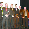 The Lebanon Community School Corporation accepted the Governor's Workplace Safety Award at a ceremony last Wednesday in Indianapolis. Pictured are, from left, Darby Miller of the Indiana Department of Labor, Lebanon Superintendent Dr. Robert Taylor, Jason Jones of Trinity Safety Solutions, Lebanon High School student Jake Marshall, LHS building and trades instructor Brad Sloan, and Indiana Lt. Governor Sue Ellspermann.