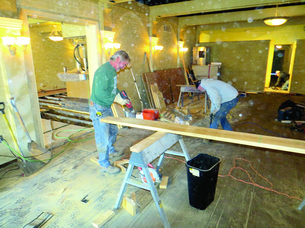Dust fills the air as crews work Friday morning, March 8, to renovate the interior of il Villagio, 40 N. Main St. The building was recently sold to Eric Bretzman and Shelley Steiner. The two are making significant improvements to the interior and exterior of the building.