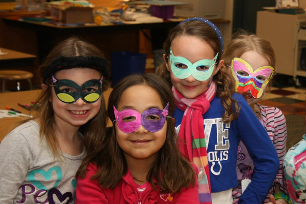 Eagle Elementary students model masks made during Eagle Extravaganza, the school's annual spring fundraiser. The event includes a dinner, silent auction, games, crafts and a cake walk. The money raised from the event will be used for enrichment clubs, field trips, school plays, special classroom projects and teacher grants. Pictured from left: Autumn Peper, Samantha Gomez, Erin McCoy and Savannah Sacino.