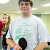 "Zionsville Community High School Freshman Adam Humphrey poses after winning the ping-pong tournament during the ""Break From Winter"" Week at ZCHS. The week was planned by the student council and included dress-up days, the tournament and penny wars. Proceeds from the week benefit the Leukemia and Lymphoma Society."