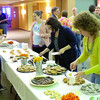 Zionsville resident Jill Robertson picks out a dessert Saturday night, March 9, at Zionsville Presbyterian Church. The church's Mothers of Preschoolers sponsored a Family Night Out. Proceeds from the event, which featured a concert by the Hunter Smith Band, benefit the Zionsville Food Pantry and MOPS. Robertson said she used to listen to Smith's previous band, Connersvine, and wanted to listen to his new band.