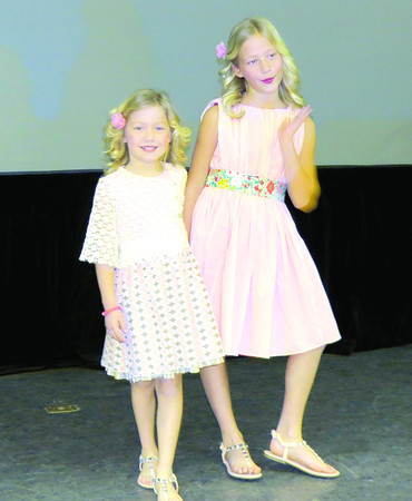 Isabel and Ava Metzger model clothes Friday afternoon, March 1, at the Zionsville Education Foundation InStyle Fashion Show.