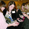 """From left, Chelle Smitson, Andi Hardesty, Greta Cline and Amy David have a quick lesson on online bidding for the silent auction at the Zionsville Education Foundation's Girls Night Out. The event, themed """"Getaway"""" and held at The Palamino Ballroom Friday night, Feb. 28, replaces the annual spring style show and luncheon. Funds raised will support ZEF's fall grant program."""