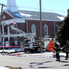 Reporter photo by Rod Rose<br /> Lebanon firefighters man a hose line at the site of a natural gas main leak Monday.