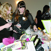 """Stephanie Armbrester and Grace Fletcher look over silent auction items at the Zionsville Education Foundation's spring fundraiser Friday night, Feb. 28, at the Palamino Ballroom. The usual spring style show and luncheon was made over into Girls Night Out with the theme """"Getaway."""" Funds raised at the event will support ZEF's fall grant program."""
