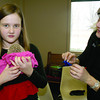 Cami Beck, 9, shows off her hedgehog, Coco, at Nature Fest, Saturday March 1. Cami's mom, Sarah Beck, at right, was teaching children about hedgehogs and their habits at the annual event, held inside Zionsville Town Hall this year.