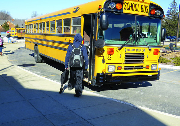 Students catch their buses after school Thursday, Feb. 27, at Zionsville Community High School.