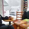 RICHARD LINDSAY - THE BERKSHIRE EAGLE<br /> Karl Lange of Stockbridge and Rebecca Dunbar from Glasgow Scotland chat in the warmth of Stockbridge Coffee & Tea Tuesday morning as blizzard Dave's outside on Elm Street in Stockbridge.