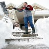 BEN GARVER — THE BERKSHIRE EAGLE<br /> Tom Dubis Shovels off the steps at the Paciorek Funeral Home In Adams, Thursday March, 8, 2018. Northern parts of Berkshire County had more snow from the storm.