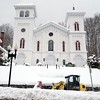 BEN GARVER — THE BERKSHIRE EAGLE<br /> Norm Charron, who works for the Town of Adams, cleans the sidewalk on Park Street, Thursday March, 8, 2018. Northern parts of Berkshire County had more snow from the storm.